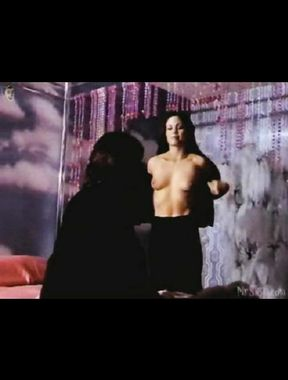 Deborah Shelton exposes big breasts